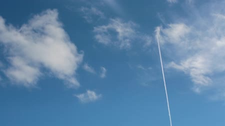 Airliner leaves a trail across the sky Stock Footage