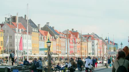 COPENHAGEN - September 2017 - Colorful buildings and tourists at the Nyhavn Waterfront in Copenhagen, Denmark