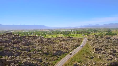 Drone reveal shot over the mountains of Ceres Valley and the town of Ceres in South Africa Stock Footage