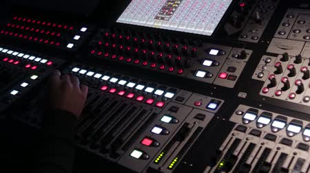 phonogram : The work of the sound engineer behind the mixing Desk at the concert.