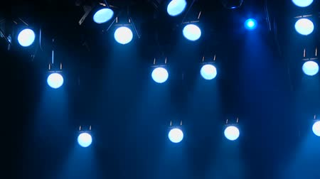 showbiz : The blue light from the spotlights. Lighting equipment. The footage is looped without gaps. Stock Footage