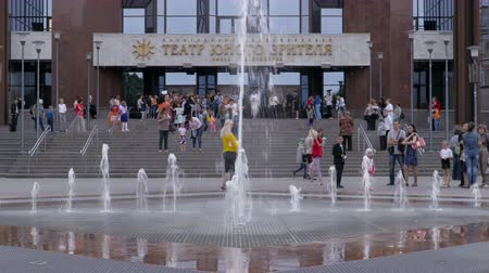 Adults and children near the fountain. Theater of the young spectator. Russia, Saratov, June 1, 2017