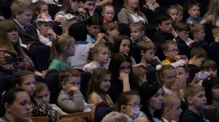 Spectators watch the show or view in the theater. Children and adults alike. Clip footage in 4K. Theater of the young spectator. Russia, Saratov, June 1, 2017