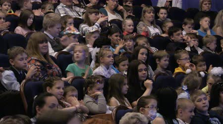 The audience is applauded for a performance or presentation in the theater. Children and adults alike. Theater of the young spectator. Russia, Saratov, June 1, 2017