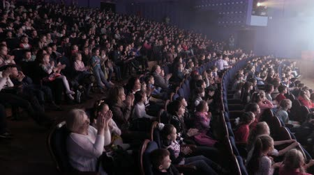 Children applauding in the auditorium during the performance. Theater for young spectators, Russia, Saratov, April 28, 2017