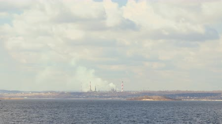 The view from the Volga river in the Factory district of Saratov city. Russia. A river landscape. Factory pipe. Environmental pollution, emissions into the atmosphere. The sky and clouds. 4K 影像素材