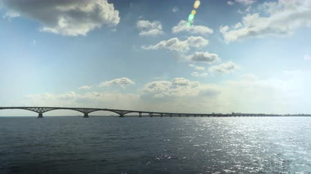 Road bridge over the Volga river between the cities of Saratov and Engels, Russia. Landscape with a river, clouds in the sky. 4K, Ultra HD, UHD. 影像素材