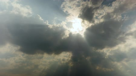 Sun rays through the clouds. Time-lapse recording. Footage 4K, UHD