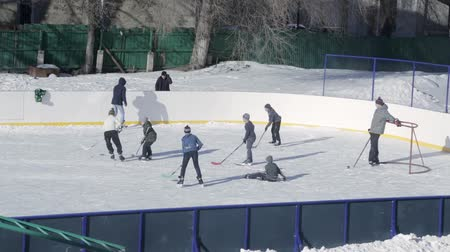 Boys playing hockey on the rink in the school yard. Russia, Saratov, 31 Jan 2017
