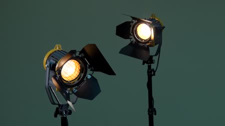 Two lights with Fresnel lenses. Halogen lamp. Activation of the device. Power adjustable with dimmer switch. Off. Photography, videography, filming, shooting. 影像素材