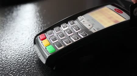 plastic processing : Mans hand swipe credit card payment on pos terminal. Closeup.