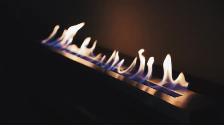 cosiness : Modern interior fireplace (bioethanol). Intentionally shooting in the dark. Modern Fireplace and Flame flickering Stock Footage