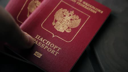 sivil : Hands putting the passport of Russian federation