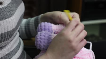 amigurumi : Knitting hand made hobby. Young woman knitting toy. Video footage