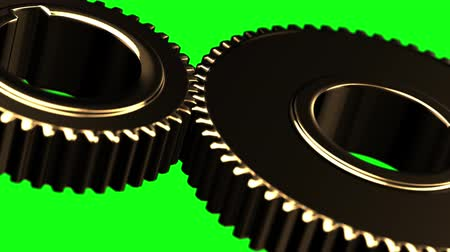 interlock : Golden gears loop rotate on green chromakey background Stock Footage