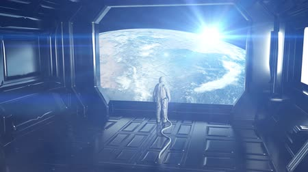 chodba : Alone astronaut in futuristic spaceship, room. View of the earth. Cinematic 4k footage