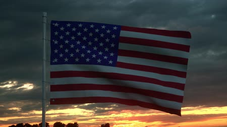 čtvrtý : USA flag waving isolated on dramatic sky. Close up of United States of America flag, 3d rendering