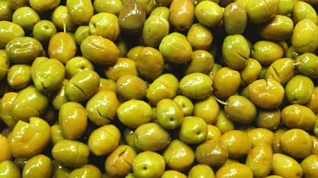 olive oil pour : Close up of fresh green olives at a market stall Stock Footage