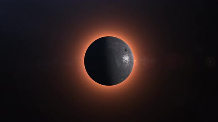 celkový : Full solar eclipse. The Moon mostly covers the visible Sun creating a gold diamond ring effect. 4K