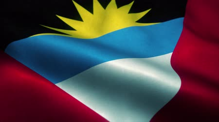 эмблема : Antigua and Barbuda flag waving. National flag of Antigua and Barbuda. Sign of Antigua and Barbuda seamless loop animation. 4K