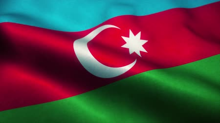 эмблема : Azerbaijan flag waving in the wind. National flag of Azerbaijan. Sign of Azerbaijan seamless loop animation. 4K Стоковые видеозаписи