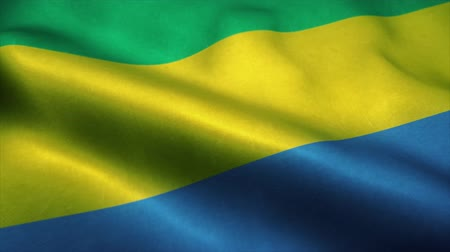 official : Gabon flag waving in the wind. National flag of Gabon. Sign of Gabon seamless loop animation. 4K Stock Footage