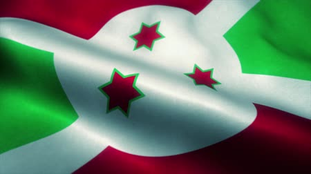 official : Burundi flag waving in the wind. National flag of Burundi. Sign of Burundi seamless loop animation. 4K