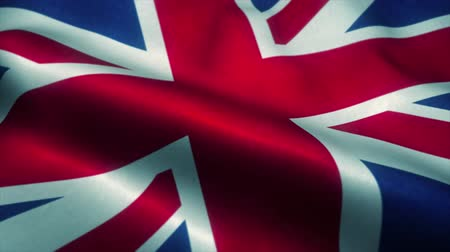 bretanha : United Kingdom flag waving in the wind. National flag of United Kingdom. Sign of United Kingdom seamless loop animation. 4K Vídeos