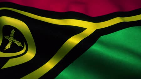 official : Vanuatu flag waving in the wind. National flag of Vanuatu. Sign of Vanuatu seamless loop animation. 4K