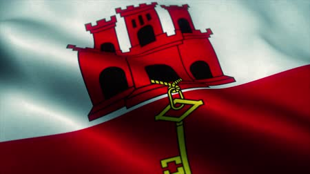 territory : Gibraltar flag waving in the wind. National flag of Gibraltar. Sign of Gibraltar seamless loop animation. 4K