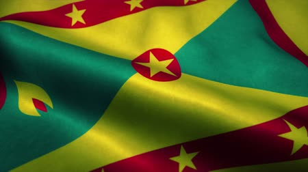 official : Grenada flag waving in the wind. National flag of Grenada. Sign of Grenada seamless loop animation. 4K Stock Footage