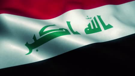 эмблема : Iraq flag waving in the wind. National flag of Iraq. Sign of Iraq seamless loop animation. 4K