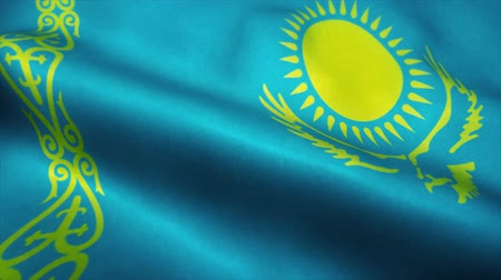 symbolic : Kazakhstan flag waving in the wind. National flag of Kazakhstan. Sign of Kazakhstan seamless loop animation. 4K Stock Footage