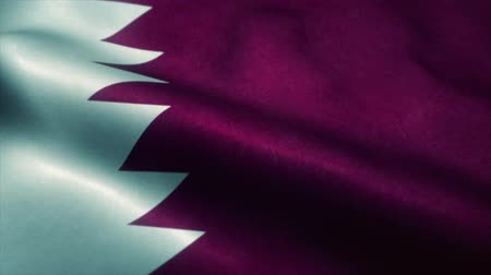 definíció : Qatar flag waving in the wind. National flag of Qatar. Sign of Qatar seamless loop animation. 4K