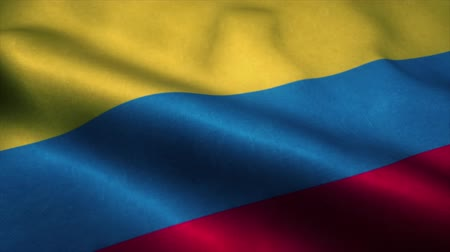 эмблема : Colombia flag waving in the wind. National flag of Colombia. Sign of Colombia seamless loop animation. 4K Стоковые видеозаписи