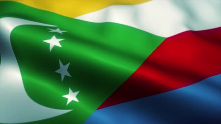 nacionalismo : Comoros flag waving in the wind. National flag of Comoros. Sign of Comoros seamless loop animation. 4K