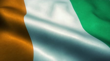official : Ivory Coast flag waving in the wind. National flag of Ivory Coast. Sign of Ivory Coast seamless loop animation. 4K