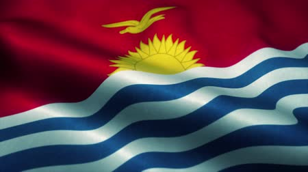 эмблема : Republic of Kiribati flag waving in the wind. National flag of Republic of Kiribati. Sign of Republic of Kiribati seamless loop animation. 4K