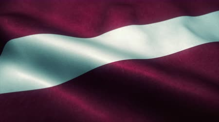 embléma : Latvia flag waving in the wind. National flag of Latvia. Sign of Latvia seamless loop animation. 4K Stock mozgókép