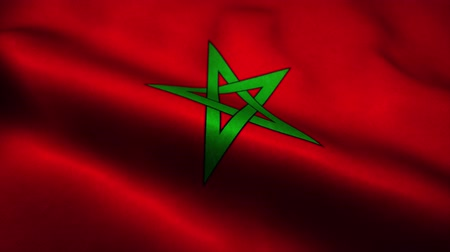 official : Morocco flag waving in the wind. National flag of Morocco. Sign of Morocco seamless loop animation. 4K Stock Footage