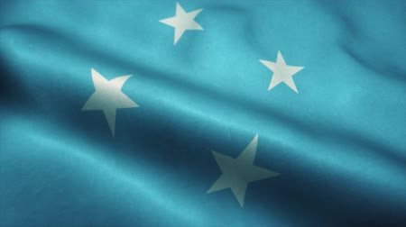 official : Micronesia flag waving in the wind. National flag of Micronesia. Sign of Micronesia seamless loop animation. 4K Stock Footage