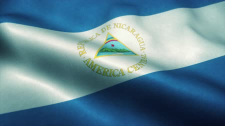 bandeira americana : Nicaragua flag waving in the wind. National flag of Nicaragua. Sign of Nicaragua seamless loop animation. 4K