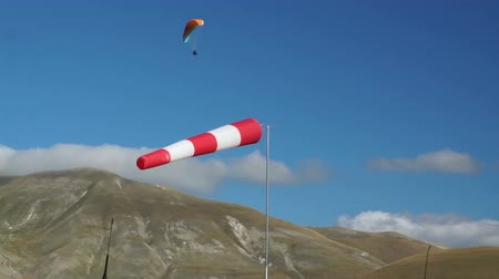pursuit plane : In mountains of Italy wind sleeve and paragliding  Stock Footage