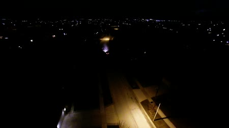 mroczne : Aerial night view of residential suburban neighborhood with street lights and rooftops