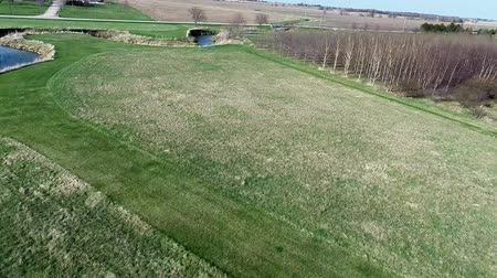 milharal : Farmland airplane fly over aerial shot early spring United States Midwest corn belt Stock Footage