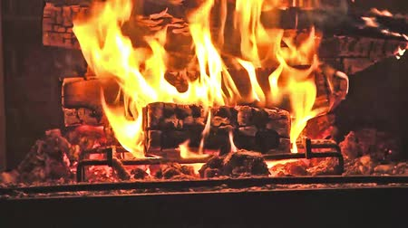 égés : Fire in fireplace - Hot embers burning with orange flame Stock mozgókép