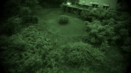 perili : Aerial view of old abandoned scary farm house Stok Video