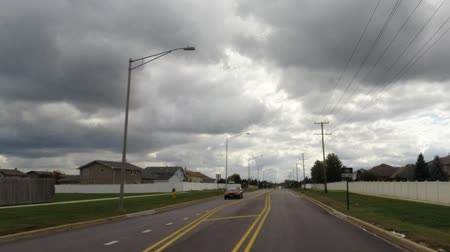 pencereler : Driving car on road looking out window in residential neighborhood on a cloudy day - Travel and leisure concept Stok Video