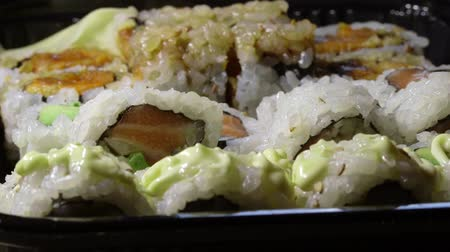 cozinha japonesa : Eating Japanese sushi with chopsticks Stock Footage
