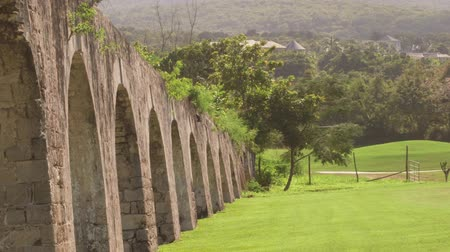 jamaica : Ancient aqueduct Montego Bay, Jamaica - Located along Jamaican shores between the majestic Blue Mountains and Caribbean Sea Stock Footage